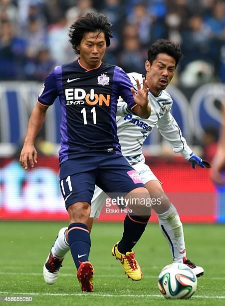Hisato Sato of Sanfrecce Hiroshima and Tomokazu Myojin of Gamba Osaka compete for the ball during the JLeague Yamazaki Nabisco Cup final match...