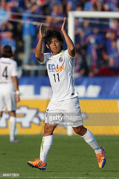 Hisato Sato of Sanfrecce Hiroshima applauds supporters as he is replaced during the JLeague match between Ventforet Kofu and Sanfrecce Hiroshima at...