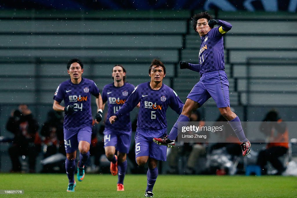<a gi-track='captionPersonalityLinkClicked' href=/galleries/search?phrase=Hisato+Sato&family=editorial&specificpeople=713823 ng-click='$event.stopPropagation()'>Hisato Sato</a> (R) of Sanfrecce Hiroshima celebrates his first goal with his team mate during the FIFA Club World Cup Quarter Final match between Sanfrecce Hiroshima and Al-Ahly SC at Toyota Stadium on December 9, 2012 in Toyota, Japan.