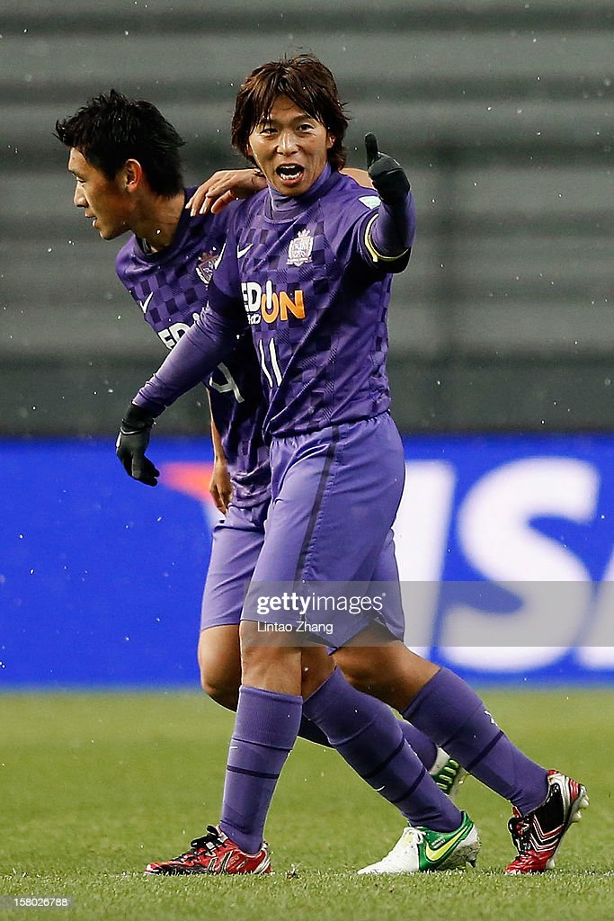 Hisato Sato (R) of Sanfrecce Hiroshima celebrates his first goal with his team mate during the FIFA Club World Cup Quarter Final match between Sanfrecce Hiroshima and Al-Ahly SC at Toyota Stadium on December 9, 2012 in Toyota, Japan.