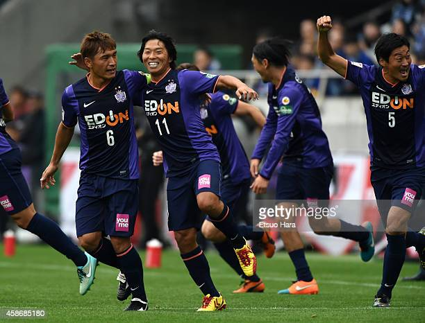 Hisato Sato of Sanfrecce Hiroshima celebrates scoring his team's first goal with his teammates Toshihiro Aoyama during the JLeague Yamazaki Nabisco...