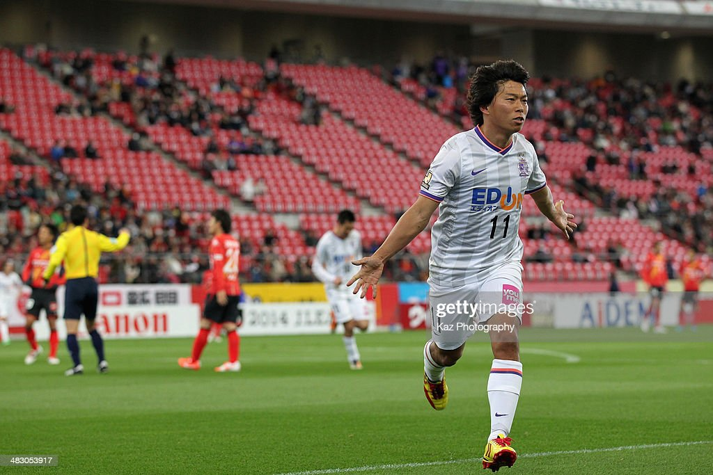 Hisato Sato of Sanfrecce Hiroshima celebrates scoring his team's first goal during the J League match between Nagoya Grampus and Sanfrecce Hiroshima...