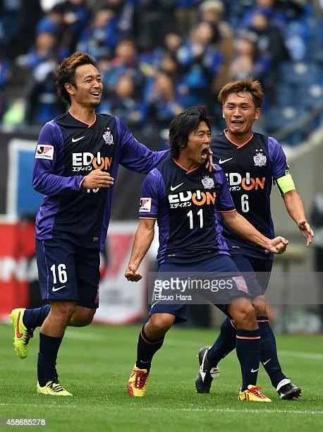 Hisato Sato of Sanfrecce Hiroshima celebrates scoring his team's second goal with his teammates Satoru Yamagishi and Toshihiro Aoyama during the...