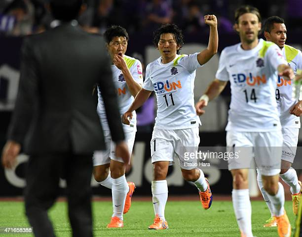 Hisato Sato of Sanfrecce Hiroshima celebrates scoring his team's second goal with his team mates during the JLeague match between Yokohama FMarinos...
