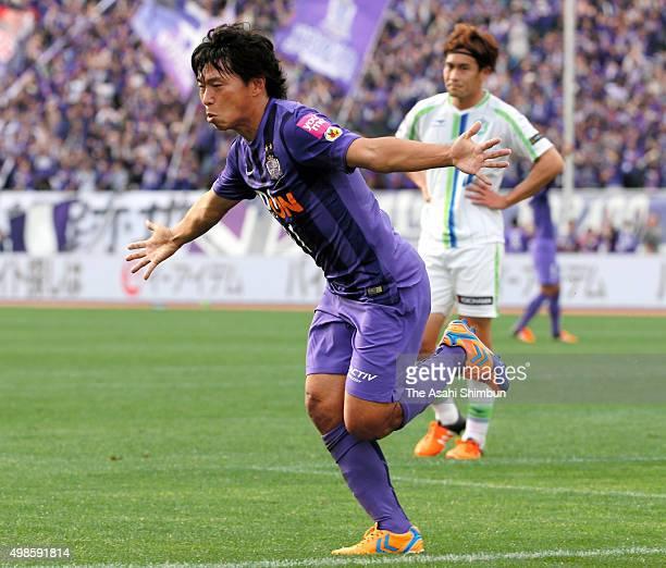 Hisato Sato of Sanfrecce Hiroshima celebrates scoring his team's third goal tying the JLeague record of 157 goals during the J League match between...