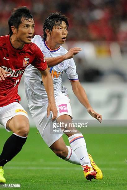 Hisato Sato of Sanfrecce Hiroshima in action during the JLeague Yamazaki Nabisco Cup quarter final second leg match between Urawa Red Diamonds and...