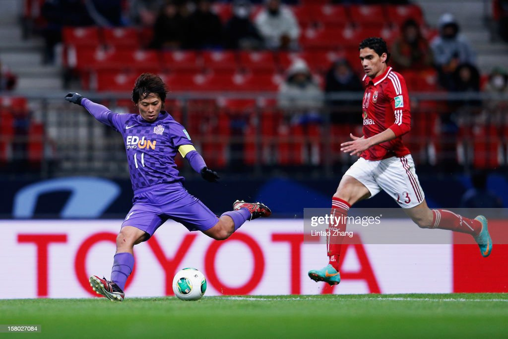 Hisato Sato (L) of Sanfrecce Hiroshima in action with Mohamed Nagieb of Al-Ahly during the FIFA Club World Cup Quarter Final match between Sanfrecce Hiroshima and Al-Ahly SC at Toyota Stadium on December 9, 2012 in Toyota, Japan.