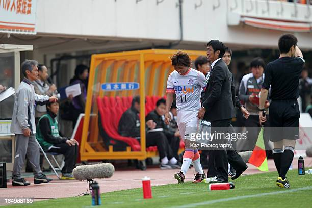 Hisato Sato of Sanfrecce Hiroshima shakes hands with head coach Hajime Moriyasu after being replaced during the JLeague match between Shimizu SPulse...