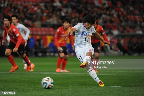 Hisato Sato of Sanfrecce Hiroshima takes the penalty kick to score his 2nd goal to lead 31 in action during the J League match between Nagoya Grampus...