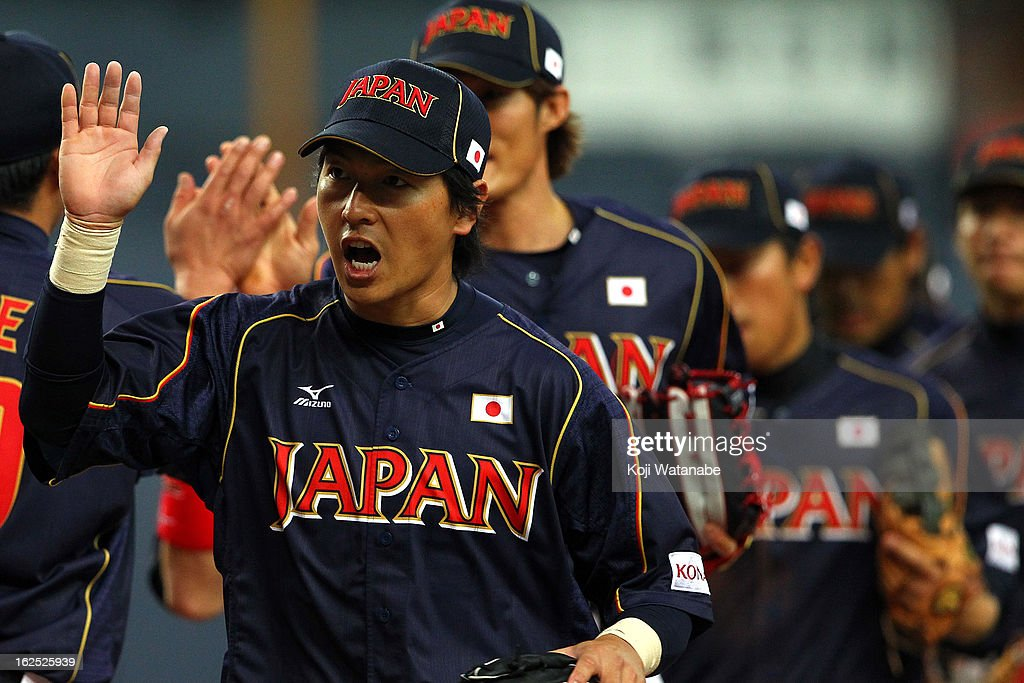 Hisayoshi Chono #34 of Japan of Japan celebrate the win after duringthe international friendly game between Australia and Japan at Kyocera Dome Osaka on February 24, 2013 in Osaka, Japan.