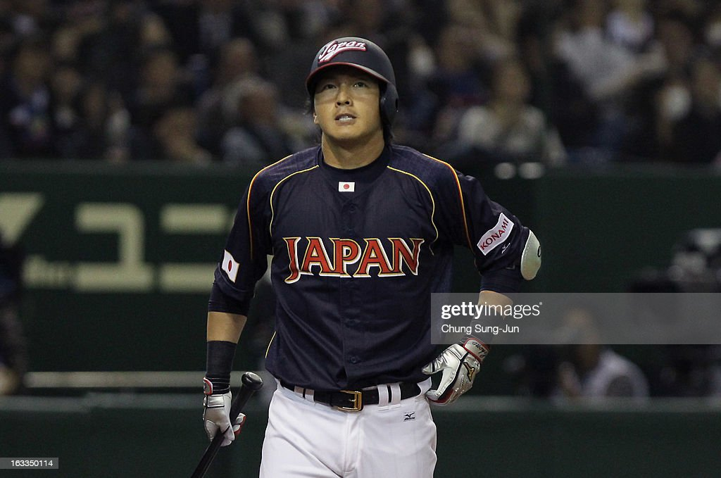 Hisayoshi Chono #34 of Japan reacts after striking out in the seventh inning during the World Baseball Classic Second Round Pool 1 game between Japan and Chinese Taipei at Tokyo Dome on March 8, 2013 in Tokyo, Japan.