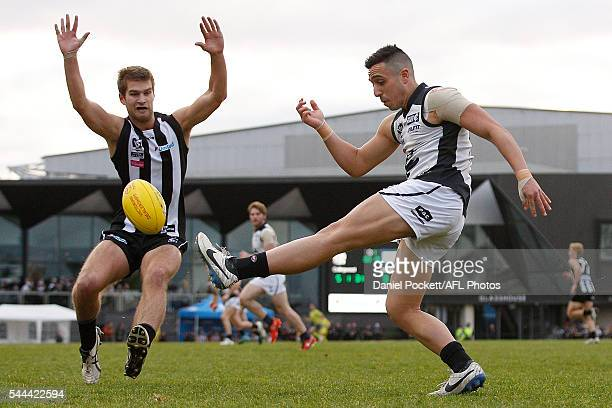 Hisham Kerbatieh of the Blues kicks the ball during the round 13 VFL match between the Collingwood Magpies and Northern Blues at the Holden Centre on...