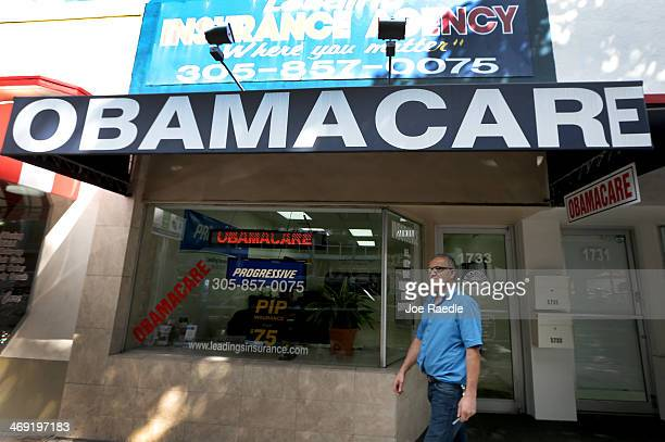 Hisham Uadadeh walks out of Leading Insurance Agency after enrolling in a health insurance plan under the Affordable Care Act on February 13 2014 in...