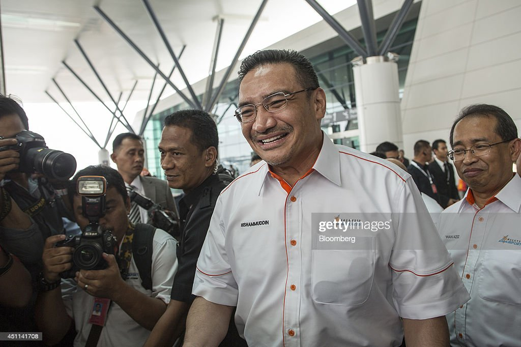 <a gi-track='captionPersonalityLinkClicked' href=/galleries/search?phrase=Hishammuddin+Hussein&family=editorial&specificpeople=774002 ng-click='$event.stopPropagation()'>Hishammuddin Hussein</a>, Malaysia's acting transport minister, arrives for the launch of Kuala Lumpur International Airport 2 (KLIA2) in Sepang, Malaysia, on Tuesday, June 24, 2014. KLIA2 will provide the needed impetus for continued growth of Malaysia's economy, Prime Minister Najib Razak said today. Photographer: Charles Pertwee/Bloomberg via Getty Images