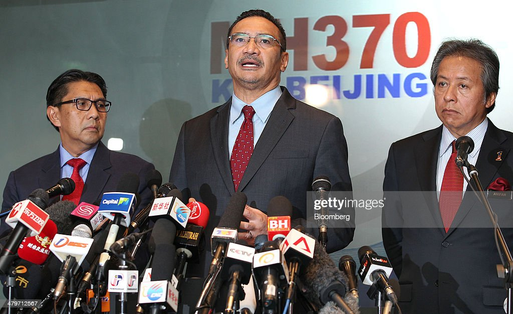 Hishammuddin Hussein, Malaysia's acting transport minister, center, speaks while <a gi-track='captionPersonalityLinkClicked' href=/galleries/search?phrase=Anifah+Aman&family=editorial&specificpeople=5958202 ng-click='$event.stopPropagation()'>Anifah Aman</a>, Malaysia's minister of foreign affairs, right, and Azharuddin Abdul Rahman, director general of Malaysia's Department of Civil Aviation, look on during a news conference in Sepang, Malaysia, on Thursday, March 20, 2014. Aircraft sent to check whether objects spotted by satellite in the southern Indian Ocean belong to the missing Malaysian passenger jet returned without making any sightings, as the search stretched into the 13th day. Photographer: Goh Seng Chong/Bloomberg via Getty Images