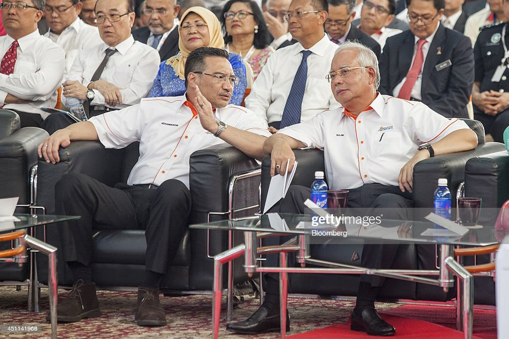 <a gi-track='captionPersonalityLinkClicked' href=/galleries/search?phrase=Hishammuddin+Hussein&family=editorial&specificpeople=774002 ng-click='$event.stopPropagation()'>Hishammuddin Hussein</a>, Malaysia's acting transport minister, left, speaks to Najib Razak, Malaysia's prime minister, during the launch of Kuala Lumpur International Airport 2 (KLIA2) in Sepang, Malaysia, on Tuesday, June 24, 2014. KLIA2 will provide the needed impetus for continued growth of Malaysia's economy, Prime Minister Najib Razak said today. Photographer: Charles Pertwee/Bloomberg via Getty Images