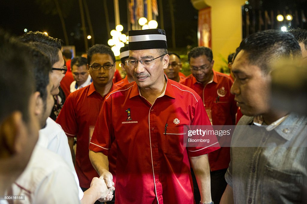 Hishammuddin Hussein, Malaysia's defence minister, centre, arrives for the United Malays National Organisation General Assembly (UMNO) General Assembly at the Putra World Trade Center (PWTC) in Kuala Lumpur, Malaysia, on Tuesday, Dec. 8, 2015. Malaysian bonds fell and the ringgit's three-day gain petered out after the New Straits Times cited Najib as saying the government faced a 30 billion-ringgit ($7 billion) shortfall in 2016 due to a slump in oil prices. Photographer: Charles Pertwee/Bloomberg via Getty Images