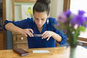 Hispanic 25 year old using mobile banking