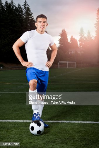 Hispanic athlete standing with soccer ball