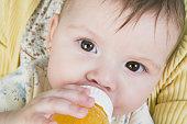 Hispanic baby drinking from bottle