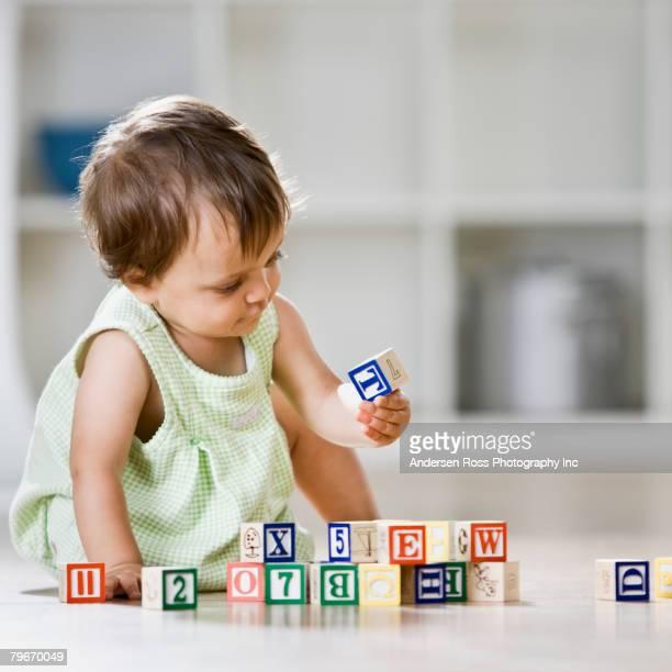 Hispanic baby playing with blocks
