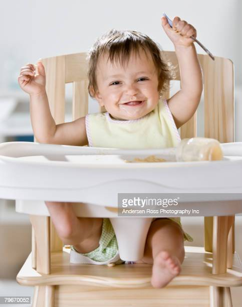 High chair stock photos and pictures getty images for Toddler sitting chair