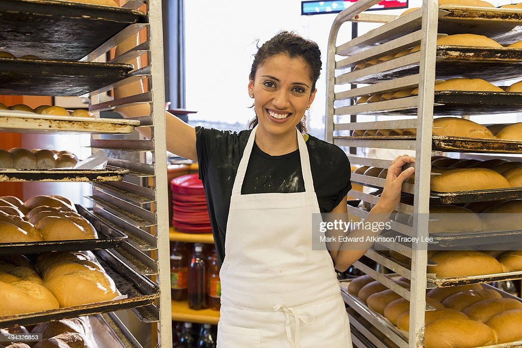 Hispanic baker working in commercial kitchen