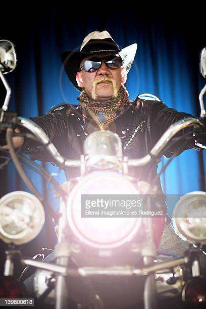 Hispanic biker sitting on motorcycle