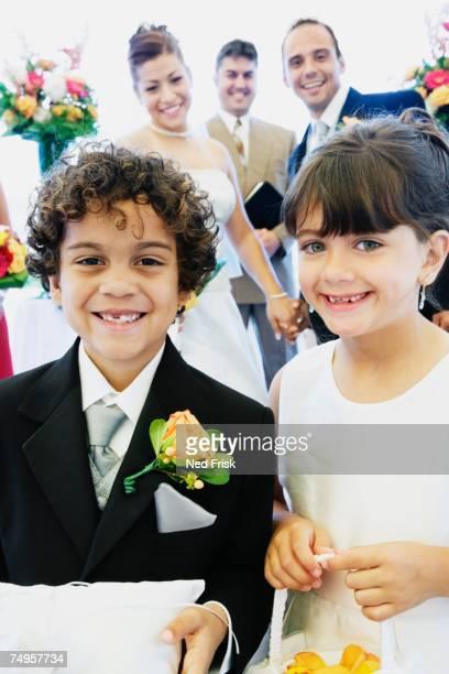 Hispanic boy and girl as ring bearer and flower girl