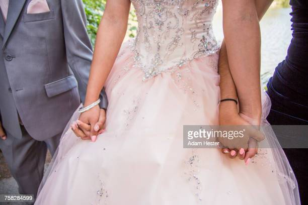 Hispanic boy and girls holding hands