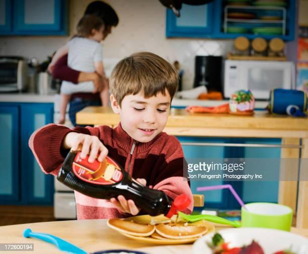Hispanic boy having breakfast