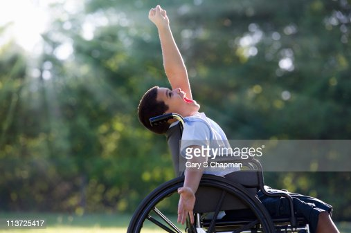 Hispanic boy in wheelchair : Foto de stock