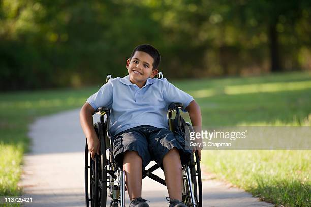 Hispanic boy in wheelchair