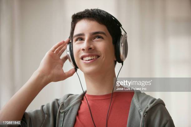 Hispanic boy listening to headphones