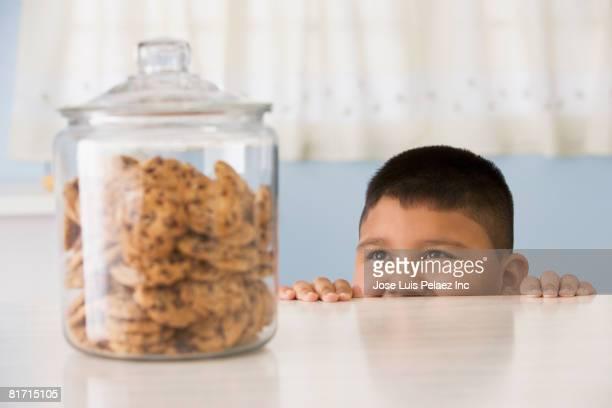 Hispanic boy looking at cookies
