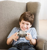 Hispanic boy playing video games