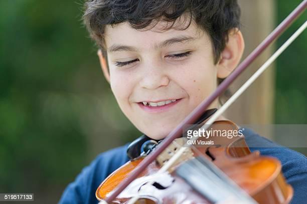 Hispanic boy playing violin