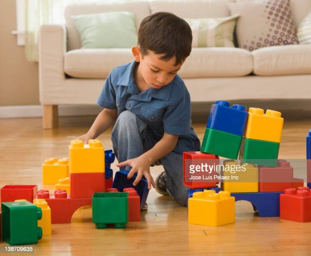 Hispanic boy playing with building blocks