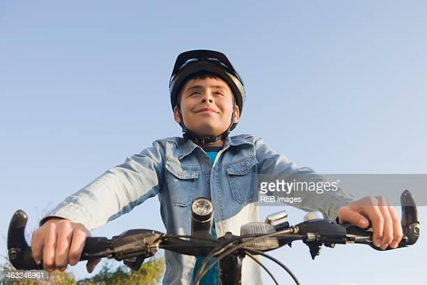 Hispanic boy riding bicycle