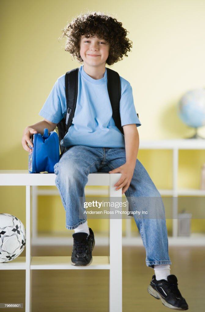 Hispanic boy wearing backpack