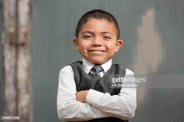 Hispanic boy wearing formal suit
