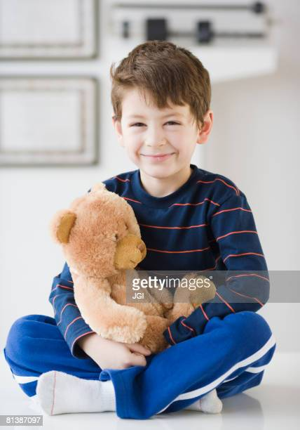 Hispanic boy with teddy bear in doctor?s office