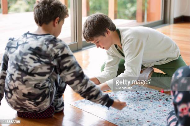Hispanic boys playing board game