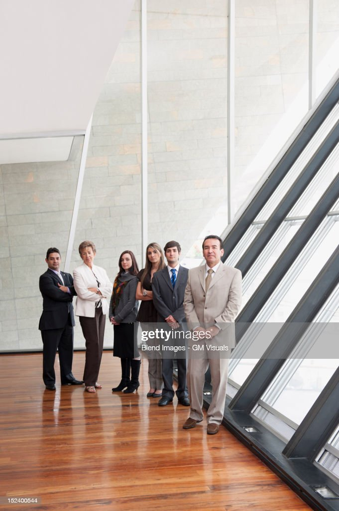 Hispanic business people standing together : Stock Photo