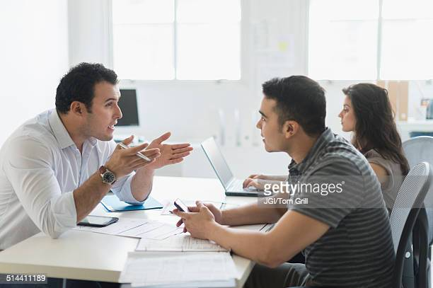 Hispanic business people working together in office