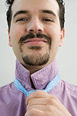 Hispanic businessman adjusting his tie