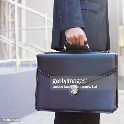 Hispanic businessman carrying briefcase