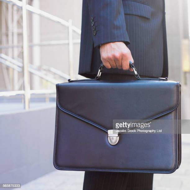 Hispanic businessman carrying briefcase