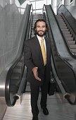 Hispanic businessman extending handshake