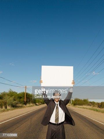 Hispanic businessman holding blank sign : Foto de stock